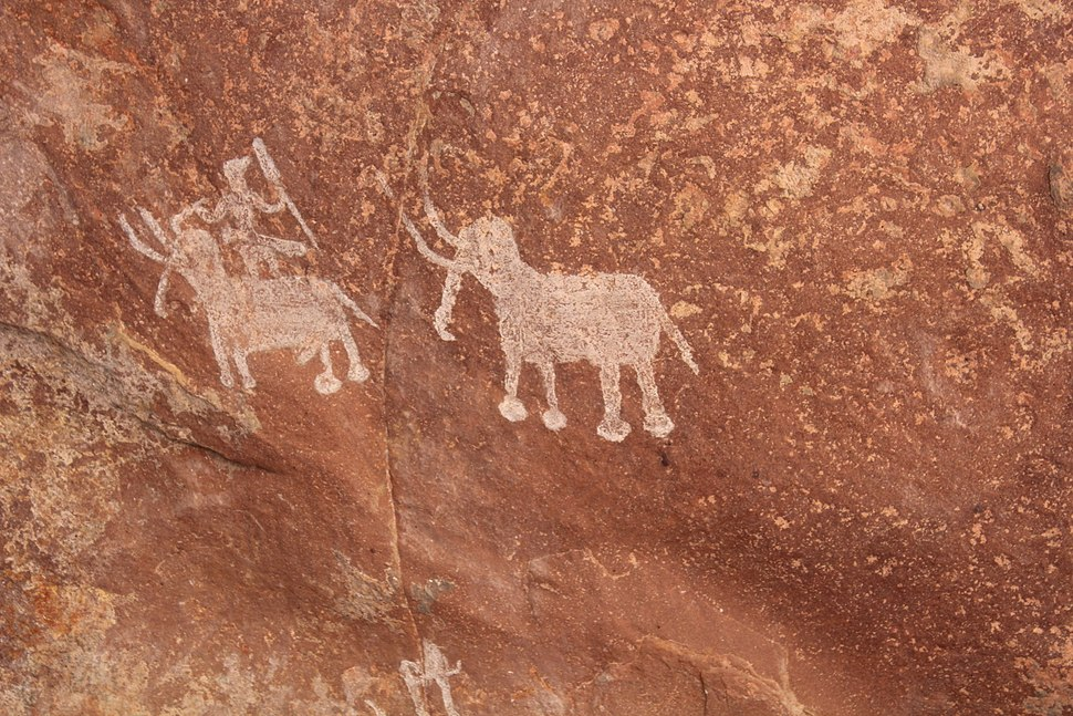 2 elephants man riding one pre historic Bhimbetka rock cave paintings Madhya Pradesh India