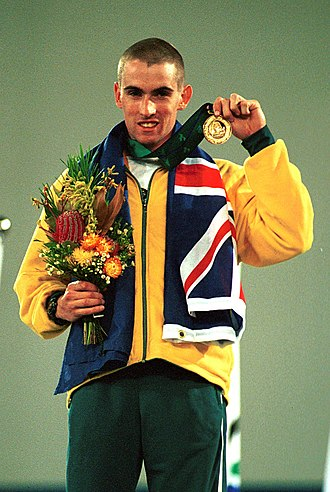 Tim Sullivan (athlete) - Sullivan shown on the gold medal podium at the 2000 Summer Paralympics. He won five gold medals at these games.