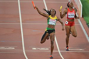 2015 World Championships in Athletics – Women's 4 × 400 metres relay - The finish, Novlene Williams-Mills celebrates ahead of Francena McCorory