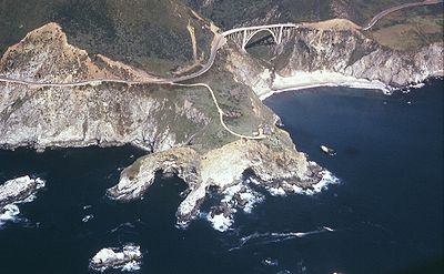 Big Sur and the Bixby Bridge near the outcropping of rocks that resembles a dinosaur, June, 1965