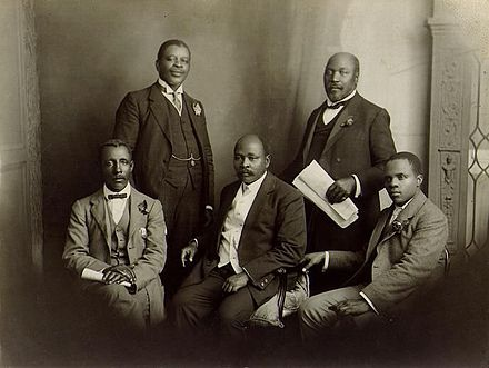 The South African Native National Congress delegation to England, June 1914. Left to right: Thomas Mtobi Mapikela, Rev Walter Rubusana, Rev John Dube, Saul Msane, and Sol Plaatje ANC1914.jpg