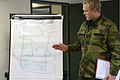 A Norwegian soldier conducts a mission brief during a military adviser team (MAT) and police adviser team (PAT) training exercise at the Hohenfels Training Area, a part of the Joint Multinational Readiness 131208-A-RJ750-005.jpg