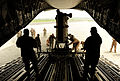 A U.S. Air Force C-17 Globemaster III aircraft assigned to the 535th Airlift Squadron, Hickam Air Force Base, Hawaii, unloads a U.S. Army CH-47 Chinook helicopter with the 16th Combat Aviation Brigade (CAB) 100902-F-KV470-180.jpg
