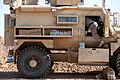 A U.S. Marine with Combat Logistics Regiment 2 restocks a vehicle with water during Operation Dynamic Partnership in Helmand province, Afghanistan 130214-M-KS710-049.jpg