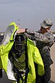 A U.S. Soldier assigned to the 61st Chemical Company assists a member of the Kuwait National Guard with his chemical protective suit during training at Camp Tarheer, Kuwait, Nov 091118-A-PT935-314.jpg