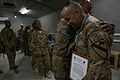 A U.S. Soldier with the 2nd Battalion, 7th Cavalry Regiment, 1st Cavalry Division congratulates Staff Sgt. Renie Arana, right, during an Audie Murphy Award ceremony at Bagram Airfield, Parwan province 130510-A-XM609-067.jpg