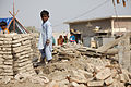 A child stands amongst the remains of buildings destroyed by the floods in Sindh province, Pakistan. (5330433865).jpg