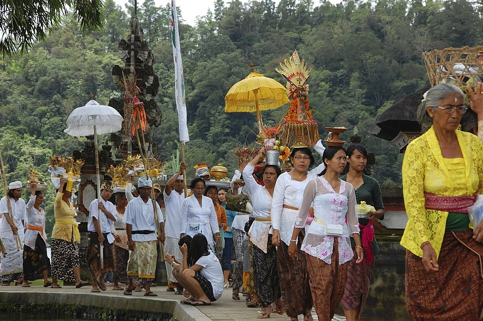 A procession with offerings entering a Hindu temple Bali