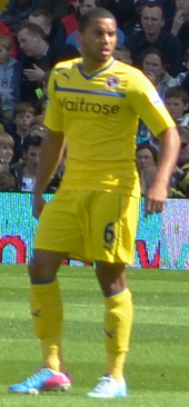 Adrian Mariappa on the football pitch wearing Reading's 2012–13 away kit