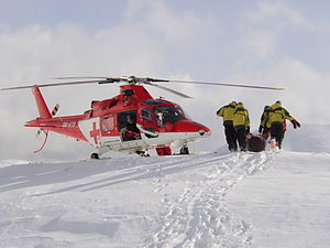Medical evacuation - An AW109 helicopter evacuates a patient from the Tatra mountains in Slovakia