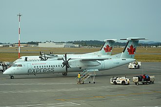 Jazz (airline) - Jazz Dash-8 Q400's in the old Air Canada Express Livery