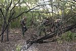 Aircrew members traverse SERE combat survival training challenges 141009-F-AD344-099.jpg