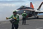 Airman Raven Romero gives the thumbs up as he verifies the weight of an F-A-18C Hornet before launching from the flight deck of the aircraft carrier USS Carl Vinson (CVN 70) during flight operations off 130610-N-ZI635-056.jpg