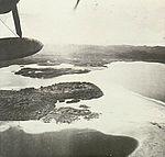 Airplane flying over Gasmata.JPG