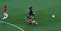 Alex Morgan leaps over defender 2012 Olympics.jpg