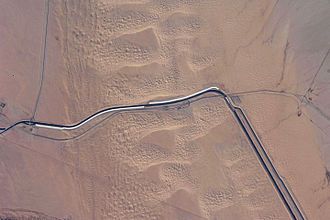 All-American Canal - View of about 15 kilometers (9.3 mi) of the All-American Canal just west of Yuma, Arizona. Note: North is to upper-right.