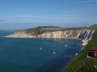 Alum Bay - The cliffs of Alum Bay, showing the steeply-dipping multi-coloured sands above the white Chalk, with shallower dips towards the northern end
