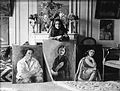 Amrita Sher-Gil with 3 paintings.jpg