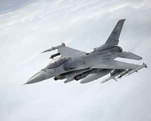 An F-16 Fighting Falcon departs after being refueled by a KC-135 Stratotanker (28404467963).jpg
