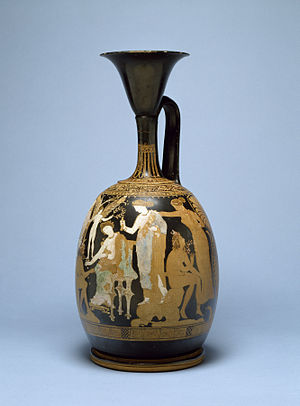 "Knucklebones - A red-figure pottery (terracotta) ""kerch"" style lekythos depicting a nymph and satyr playing at knucklebones, with two Eros figures (standing between Aphrodite) offering laurel wreaths of victory to the nymph and to a youth, c. 350 BC"