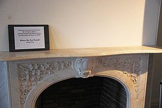 Fireplace mantel - Fireplace mantel of a marble slab atop decorative stonework, at Arlington House