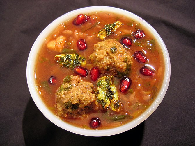 A bowl of ash-e anar, a Persian soup made with...