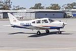 Australian Airline Pilot Academy (VH-XEA) Piper PA-28-161 Cherokee Warrior III taxiing at Wagga Wagga Airport.jpg