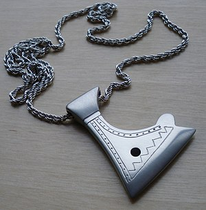 "Axe of Perun - Modern day ""Axe of Perun"" amulet based on a finding from the Khazar fortress Sarkel (Саркел), excavated in the 1930s. The Kievan Rus' controlled the fortress from 965 until the 12th century."