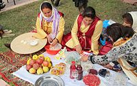 Azerbaijan-Pomegranate Festival woman in national costumes (e-citizen).jpg
