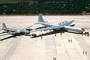 Revolt of the Admirals - The Convair XB-36 Peacemaker bomber prototype dwarfs a Boeing B-29 Superfortress bomber, the largest bomber of World War II.