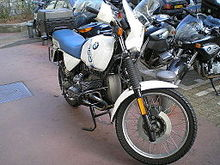 White BMW R100GS parked in front of some other motorcycles