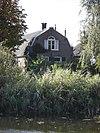 Boerderij, gepleisterd dwarshuis, topgevel, rieten dak