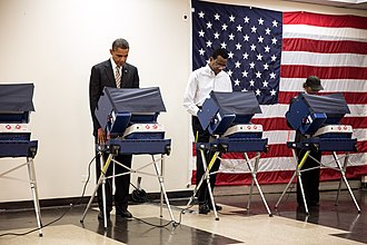 2012 United States presidential election - President Obama casts his ballot at the Martin Luther King Jr. Community Center in Chicago.