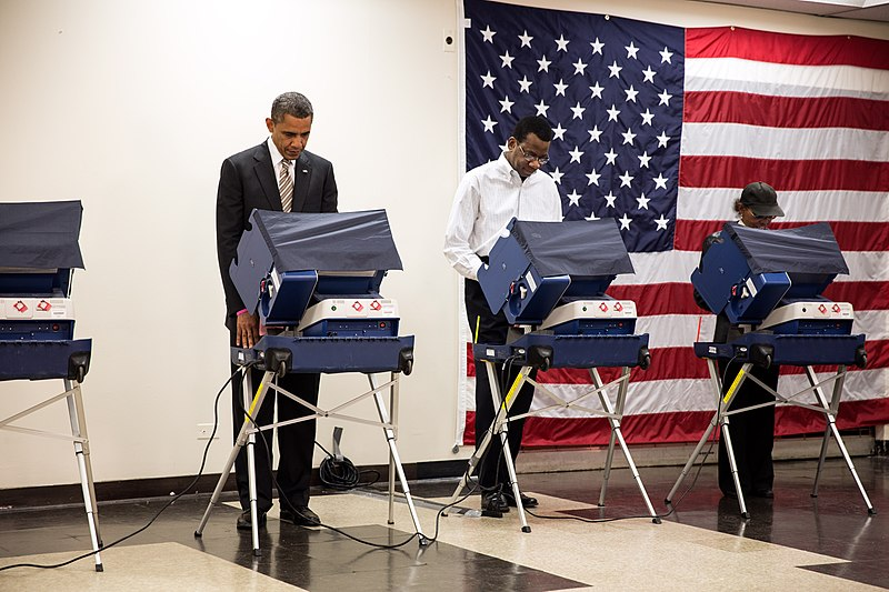 Barack Obama votes in the 2012 election.jpg