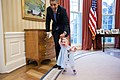 Barack Obama walks with Lincoln Rose Pierce Smith, 2014.jpg