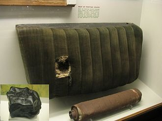 Benld, Illinois - Photo of the car seat and muffler hit by the Benld meteorite with the meteorite inset.