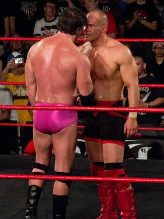 Lance Storm - Storm (right) facing off against Mike Bennett at Showdown in the Sun in 2012.