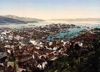 Bergen - An historic photochrom of Bergen near the end of the 19th century. Visible are Bergen Cathedral (Domkirken) in the bottom left corner, Holy Cross Church in the middle, the bay (Vågen) with its many boats and the Bergenhus Fortress to the right of the opening of Vågen.
