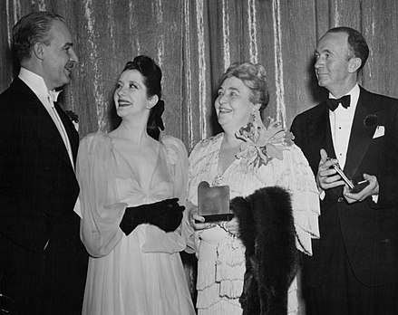 Alfred Lunt and Lynn Fontanne congratulate Darwell and Walter Brennan on their Academy Awards for Best Supporting Actress and Actor, February 28, 1941. Best supporting actor and actress 1940.jpg