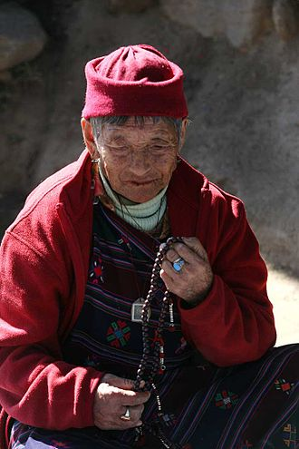 Japa - A Bhutanese Buddhist woman doing Japa, with prayer beads.