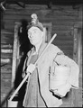Blaine Sergent ready to go to the mines. Short pole in his right hand is used to provide extra support as he walks... - NARA - 541384.tif