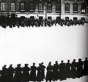 "Bloody Sunday (1905) - Still from the Soviet movie Devyatoe Yanvarya (""9th of January"") (1925) showing a line of armed soldiers facing demonstrators at the approaches to the Winter Palace in St Petersburg"