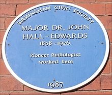 """A plaque with the inscription 'Birmingham Civic Society, Major Dr. John Hall-Edwards, 1858-1926, Pioneer Radiologist worked here, 1987'"""