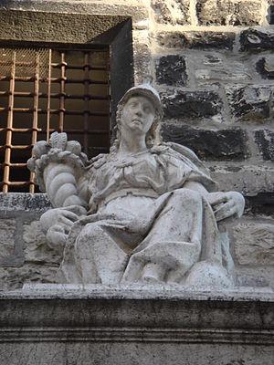 Piermaria Bagnadore - Pier Maria Bagnadore design, Fountain della Pallata Tower, detail of allegory of the city of Brescia with arms and cornucopia, 1596.