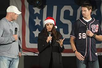 Meghan, Duchess of Sussex - Markle and sportsmen Brian Urlacher and Doug Fister address the audience during a USO show at Naval Station Rota, Spain, December 6, 2014.