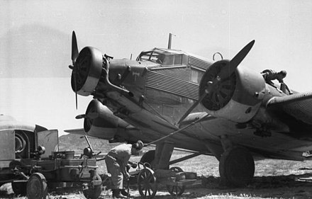 A Luftwaffe Ju 52 being serviced in Crete in 1943: Note the narrow-chord Townend ring on the central engine and the deeper-chord NACA cowlings on the wing engines. Bundesarchiv Bild 101I-026-0122-32A, Griechenland, Kreta, Ju 52.jpg