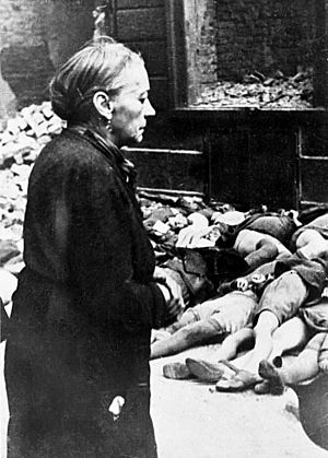 Area bombing directive - An elderly woman in front of the bodies of school children in Cologne, Germany, after a bombing raid