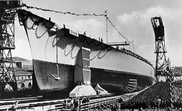 "The battleship Tirpitz sliding down the slipway at her launch Bundesarchiv DVM 10 Bild-23-63-40, Schlachtschiff ""Tirpitz"", Stapellauf.jpg"