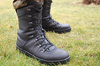 Combat boot rugged, laced boot worn by soldiers during combat or training