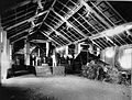 COLLECTIE TROPENMUSEUM Het interieur van het molenhuis met de Maxwellmolen op de suikeronderneming Kalibagor op de voorgrond eerste machinist Ottenhoff op de achtergrond tweede machinist Van Stenus. TMnr 60004333.jpg